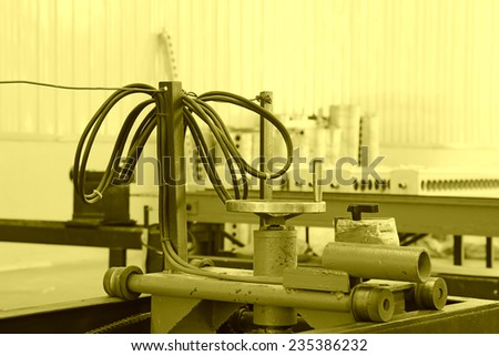 production equipment in a manufacturing factory, closeup of photo
