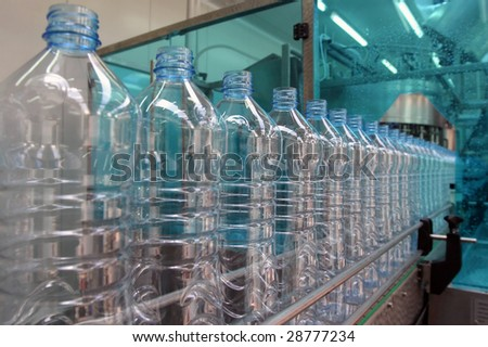 production line in a factory for mineral water - stock photo