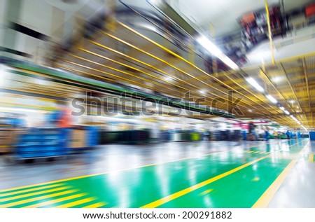 Production of automobile engine plant, motion blur picture. - stock photo
