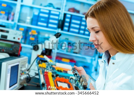 Production of electronic components at high-tech factory - stock photo