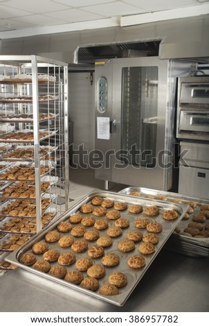 production of tasty cakes in the bakery - stock photo