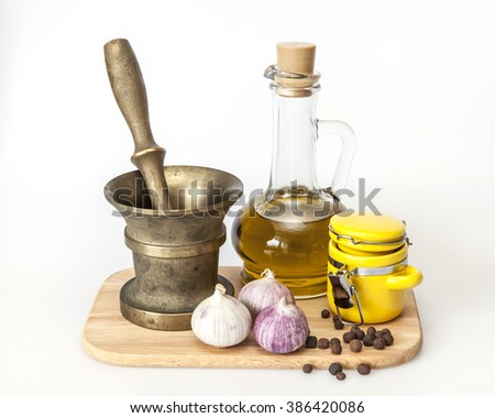 Products and kitchen utensils for cooking of garlick seasoning - stock photo