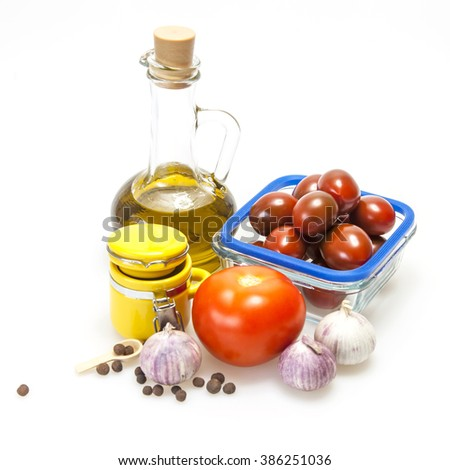 Products and kitchen utensils for cooking of seasoning from garlick and tomatoes - stock photo