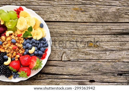 Products for a healthy breakfast,berries, fruits, nuts and granola,top view. - stock photo