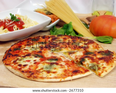 products of italian cucine with macaronni on tomato sauce and tasty pizza