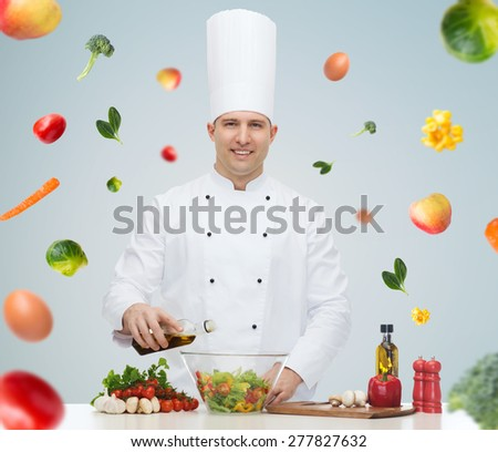 profession, vegetarian, food and people concept - happy male chef cooking vegetable salad over gray background - stock photo