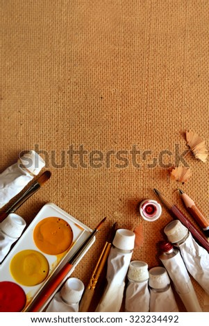 Professional acrylics paints in tubes on a painter palette - stock photo