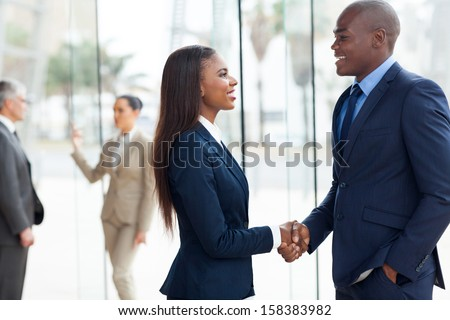 professional african business people handshaking in office - stock photo