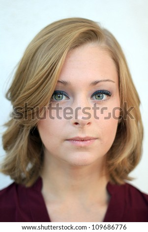 Professional and Attractive Business Woman Looking Seriously at the Camera - stock photo