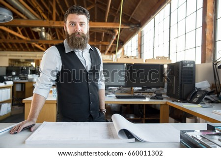 Professional Architect Or Designer Standing At Desk With Paperwork  Blueprint Design Layout