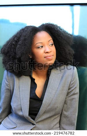 Professional Attractive African American Business Woman With Black Hair Wearing Black and Grey Suit Serious  - stock photo