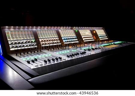 professional audio mixer in a recording studio - stock photo