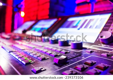 Professional audio sound mixer with buttons and sliders .  Selective focus . A little of DOF. - stock photo
