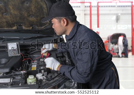 terrorist has dynamite bomb jacket train stock photo 381106363 professional auto mechanic uses a voltmeter to check the voltage level of a car fuse box