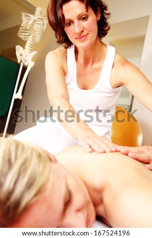 Professional  back, shoulder massage from a physiotherapist - stock photo