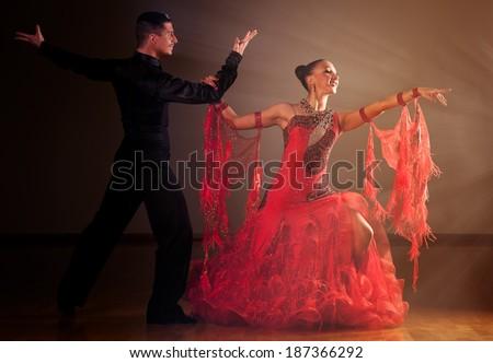 Professional ballroom dance couple preform an romantic exhibition dance - stock photo