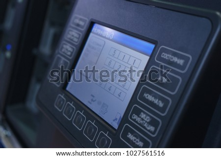 Professional banking equipment for calculating banknotes and cash. Liquid crystal display of a special apparatus, a device for counting money with several compartments.