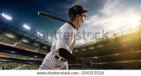 Professional baseball player in action on grand arena - stock photo