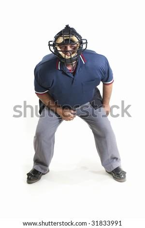 Professional baseball umpire on white background - stock photo