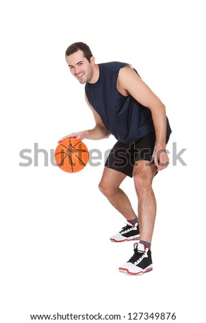 Professional basketball player with ball. Isolated on white - stock photo