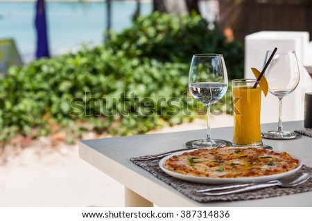 Professional beach restaurant serving with glasses and plates