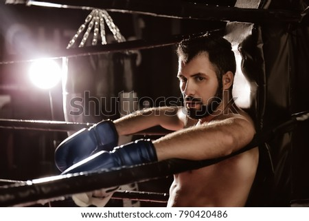 Professional boxer having break during training