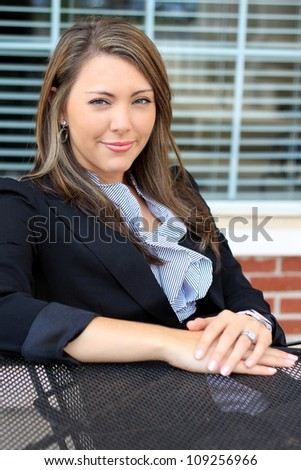 Professional Brunette Business Woman Smiling Arms Sitting Down - stock photo