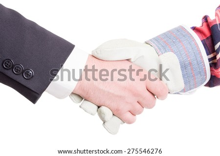 Professional builder wearing gloves and elegant suited business contractor hand shake - stock photo