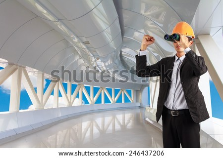 professional builder wearing helmet and hand show up . man see vision forward and success of future on the background of crooked bridge  - stock photo