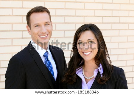 Professional Business Man and Woman Businesswoman Businessman Team Confident and Happy - stock photo
