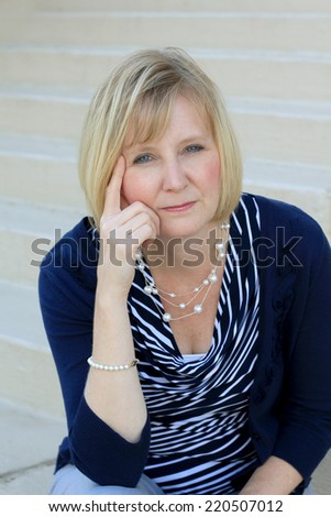 Professional Business Outside Natural Pose Blonde Thinking Baby Boomer  - stock photo