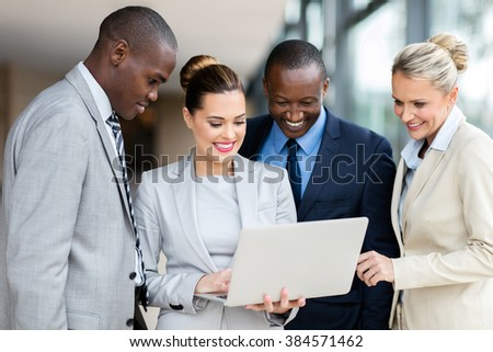 professional business people using laptop computer in office building - stock photo