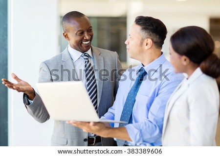 professional business team working on laptop - stock photo