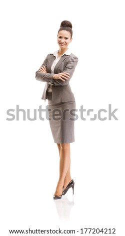 Professional business woman in suit. Full body studio portrait isolated on white background. - stock photo