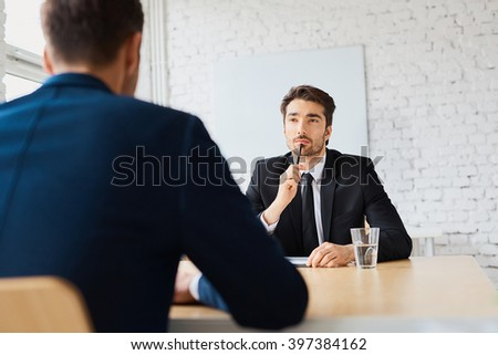 Professional businessman during job interview - human resources concept