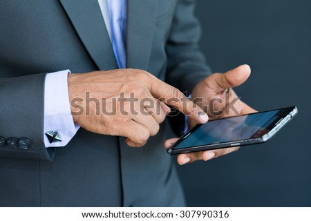 Professional businessman using a smart mobile phone - stock photo