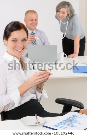 Professional businesswoman attractive drink coffee sitting by office desk