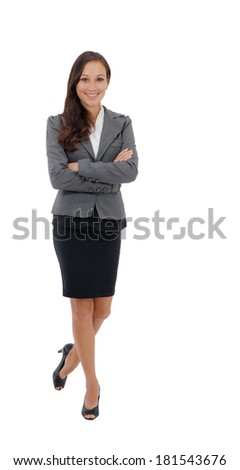 Professional businesswoman standing confident in skirt suit isolated on white background.