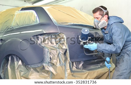 Professional car painting after body repair. - stock photo