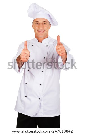 Professional chef in white hat with ok sign - stock photo