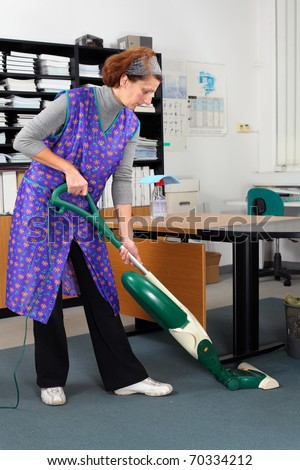 professional cleaning lady at her work in the office - stock photo