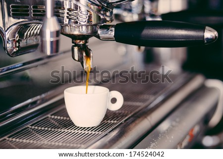 Professional coffee machine making espresso in a cafe