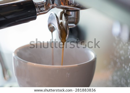 Professional coffee machine making espresso in a cafe - stock photo