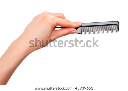 Professional comb in the hand isolated on white background