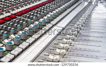 Professional console in recording studio - stock photo