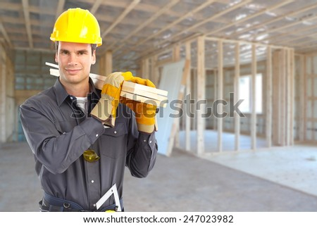 Professional construction worker in  new house. Renovation. - stock photo