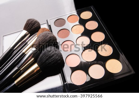 professional cosmetics for make up on black background
