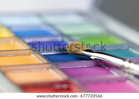 professional cosmetics. Palette of pink and blue eye shadow and the makeup brush, Shallow depth of field