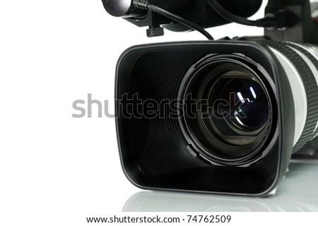 Professional digital video camera, isolated on white background. - stock photo