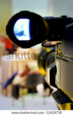 Professional digital video camera shoots the TV show - stock photo
